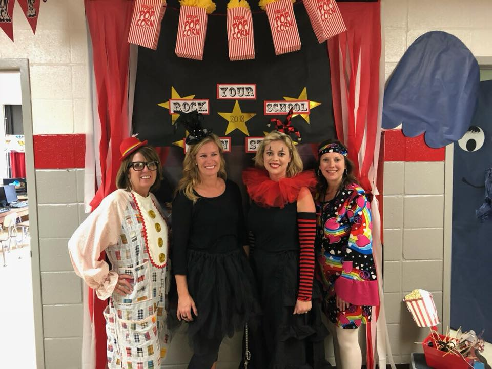 2nd grade teachers in front of picture backdrop