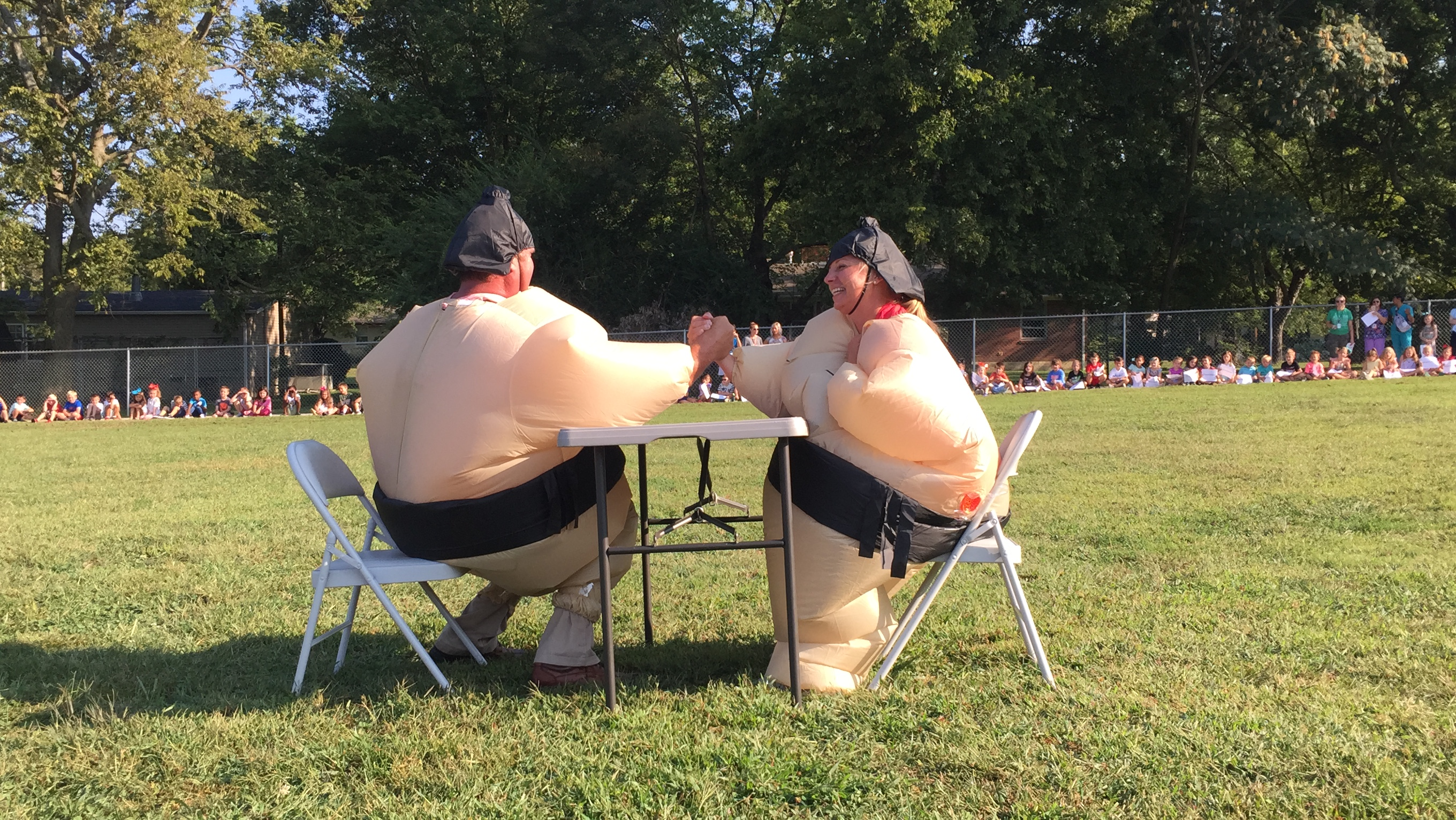 Mr. Taylor and Mrs. Holleman in Sumo suits arm wrestling