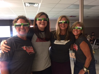 4th grade teachers with Solar Eclipse Glasses on