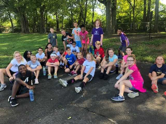 5th grade kids getting some shade after their run