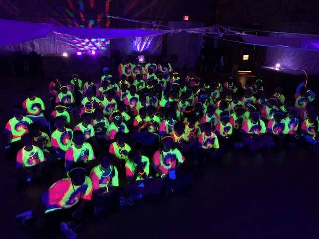 Students having a glow party at LBL