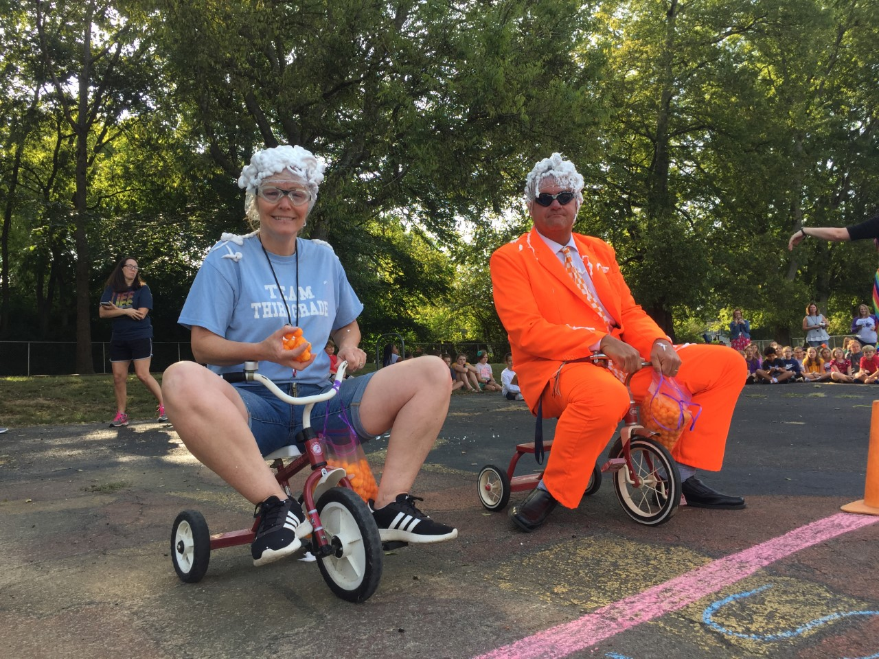 Mrs. Wood & Mr. Taylor on tricycles